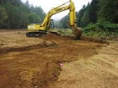 Figure 13. Excavation of the Anderson Creek high flow channel in the regraded Anderson Creek floodplain.