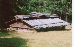 Figure 4. Yurok-style plank house similar to those built by north coastal tribes through the 19th century. This particular plank house is from the Sumêg Village, located inside Patrick's Point State Park, California. Source: Coquille Indian Tribe