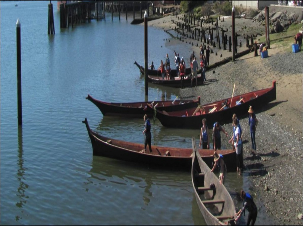 "Present day ""Chinuk"" style canoes at the annual Salmon Festival celebration in Coos Bay.  Source: Coquille Indian Tribe"