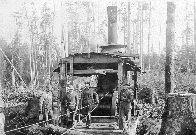 Logging yarder with Henry Metcalf Sr. c1930's.  Source: Coquille Indian Tribe