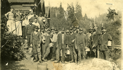 Miners at the turn of the century in front of the Henryville Mine (Later renamed Delmar Mine), approximately eight miles south of Coos Bay on the east bank of Isthmus Slough. Source: Coos History Museum and Maritime Collection, CHM 973-63d